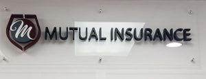 Acrylic lobby signage for Mutual Insurance in Miami, FL