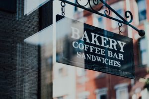 Outdoor Hanging Signs for Bakery in Miami, FL